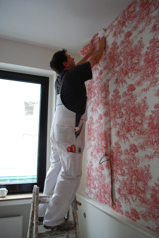 Check for mold behind vinyl wallpaper.